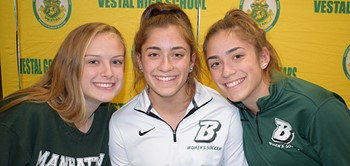 Three Vestal Girls Varsity Soccer teammates, Kaitlyn Cooke, Victoria McKnight and Olivia McKnight smile for a photo before their National Letter of Intent signing ceremony on November 14 at Vestal High School