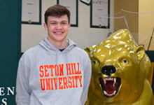 Vestal High School senior Connor Zostant by the Vestal Golden Bear statue.