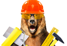 Bear wearing construction helmet and holding tools