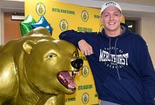 Mason Mabee next to the Vestal Golden Bear statue