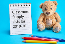 Stuffed Teddy Bear next to a stenographer's notebook with the words Classroom Supply Lists for 2019-20; A few colored pencils are laying in front of the bear and notebook.