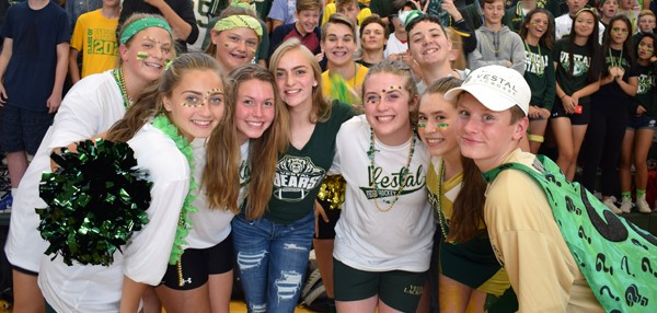 A group of juniors show their green and gold during the Fall Pep Rally at Vestal High School on October 5, 2017.