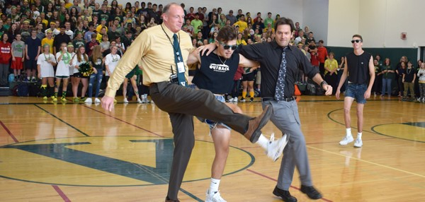"Vestal HS Principal and high school art teacher do a can-can kick as they take part in a ""dance off"" with seniors during the Fall Pep Rally on October 5, 2017."