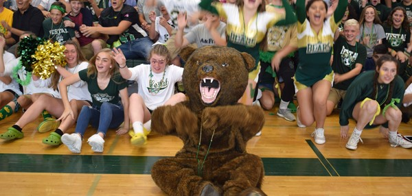 """Timber"" one of the Vestal Golden Bears leads freshmen in their first-ever ""Rollercoaster"" at Vestal High School during the Fall Pep Rally on October 5, 2017."