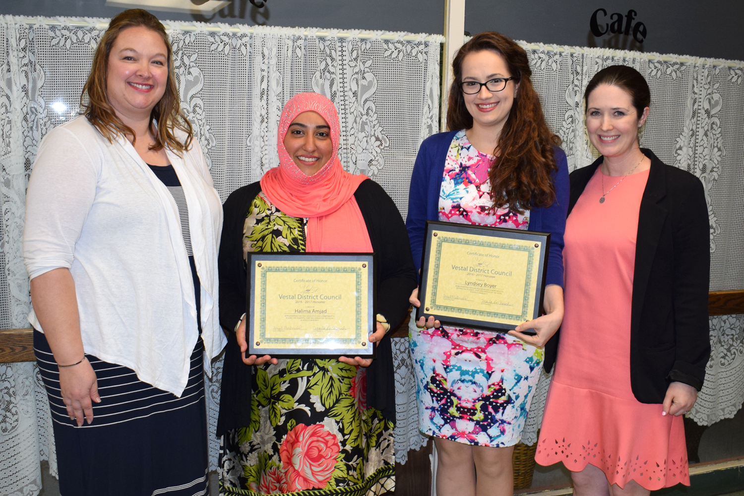 African Road P T A  Co-President Marla French with Honorees Halima Amjad and Lyndsey Boyer, and Afri