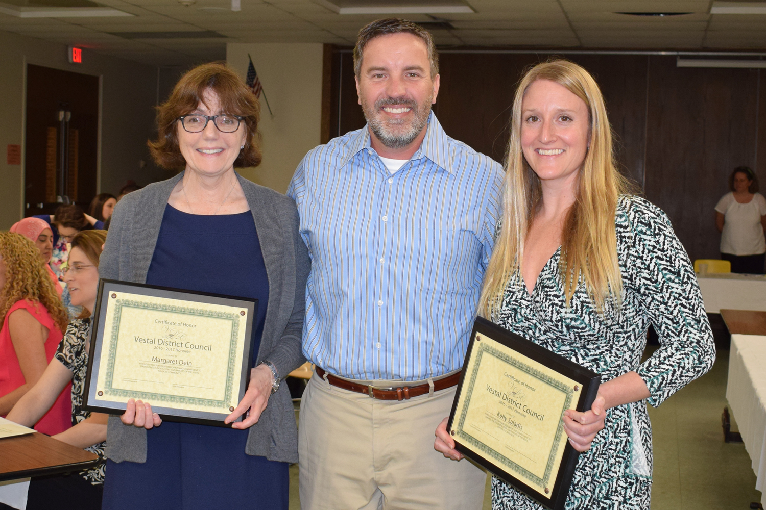 C A P T O  Honorees Margaret Dein and Kelly Saladis pose with District Council representative Derek