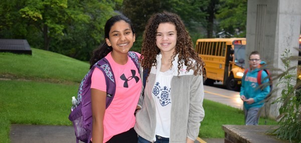 Two seventh-grade friends, both girls, pose for a photo on opening day at Vestal Middle School.