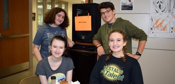 Four members of the Tech Club pose for a photo during the Vestal High School Club Fair on October 10, 2018, in the school lobby