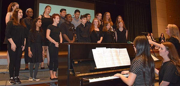 A middle school chorus performs during a School Board meeting as part of a School Spotlight at Vestal Middle School on October 9, 2018