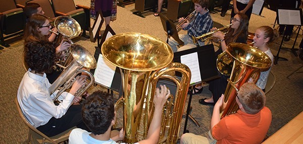 The Vestal Middle School brass quartet performs during a School Board meeting in the auditorium during a School Spotlight on October 9, 2018