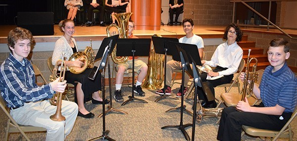 The Vestal Middle School brass quartet gets ready to shine during a School Spotlight at the beginning of the school board meeting at Vestal Middle School on October 9, 2018