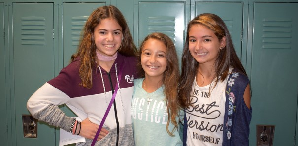 Three Vestal Middle School students hang out by their lockers during orientation in August 2017.