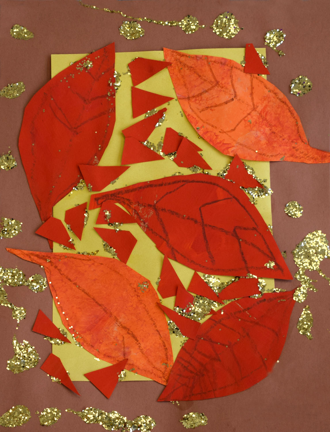 Paper montage of leaves glued to a yellow and brown background and accented with pencil-drawn veins