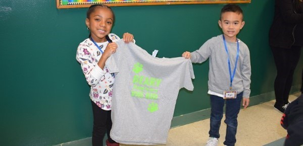 "Two Kindergarten students hold a ""Vestal Hills Elementary"" tee shirt that each received as a gift during Orientation in September."