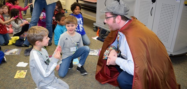 Two Glenwood first-graders talk to the Word Detective while on a Super-secret mission to the Super-secret Detective Agency in November.