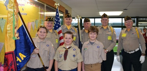 Cub Scouts who are fifth-graders at Tioga Hills Elementary lead the procession along with veterans from the American Legion for a parade through the school in honor of Veterans Day