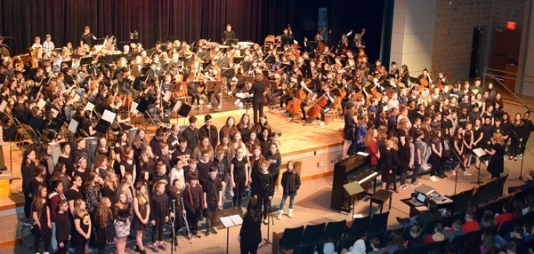 "The entire Vestal Middle School grades 7/8 chorus, band, orchestra and sixth-grade beginning band assemble in the African Road Auditorium on February 23 for a special assembly to kick off ""Music in our Schools"" month."