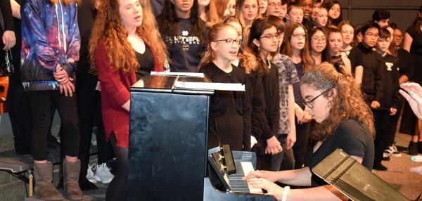 "Vestal Middle School chorus students (grades 7 and 8) sing as another student plays the piano during an assembly on February 23 to kick off ""Music in our Schools"" month, which is March."