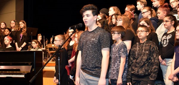 "A male student begins singing the Ed Sheeran song ""Castle on the Hill"" during an assembly to kick off ""Music in our Schools"" month at Vestal Middle School on February 23, 2018."