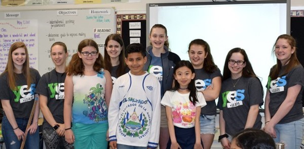 Three Vestal Hills fifth-grade students who participated in the Safe Choices' role-playing exercise pose for a photo in their classroom with members of the Vestal High School YES Leads team who came to present on May 9, 2018