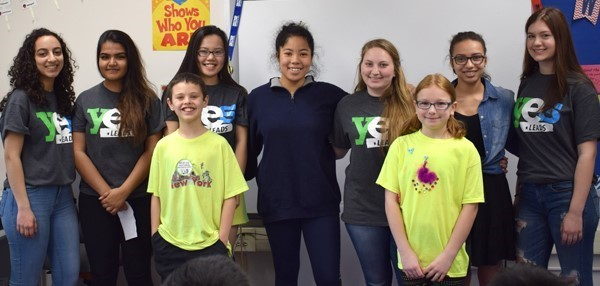 Two Vestal Hills fifth-graders who participated in the Safe Choices' exercise join the Vestal High School YES Leads team members who presented to their class for a photo