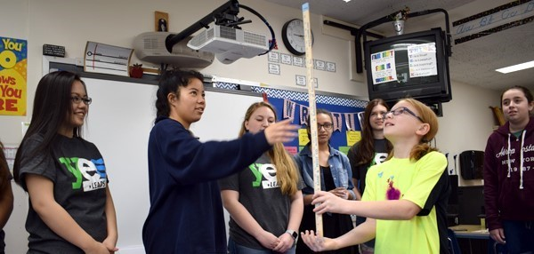 A fifth-grade Vestal Hills Elementary School girl tries to balance a ruler on her hand as part of a YES Leads exercise designed to show students how much easier it is to make tough decisions if you look toward the future