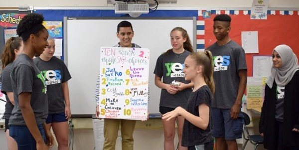 "A member of the Vestal High School YES Leads team works with a Vestal Hills Elementary School fifth-grade girl to act out one of the ways to say ""No!"" when asked to engage in risky behavior by a peer"