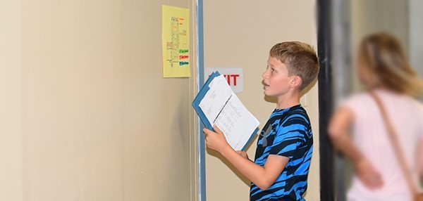 A new sixth-grader (boy) checks the Vestal Middle School map during Orientation on August 27, 2018