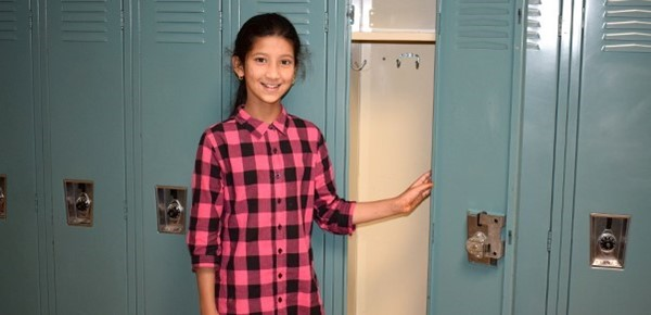 A girl successfully opens her locker during Sixth-grade Orientation at Vestal Middle School on August 27, 2018