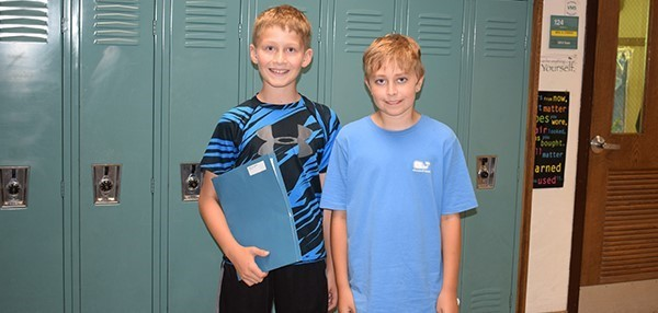 Two sixth-grade boys find the classrooms on their schedules together during Vestal Middle School's Sixth-grade Orientation on August 27, 2018