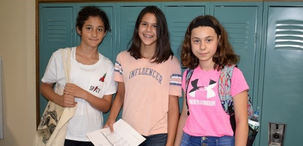 Two incoming sixth-grade girls and one older sister find their lockers during Orientation at Vestal Middle School on August 27, 2018