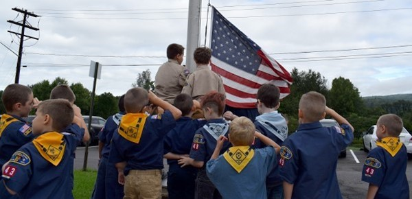 Cub Scouts help Mr. Doolittle raise the flag during Tioga Hills Elementary School Patriot Day ceremony on September 11, 2018