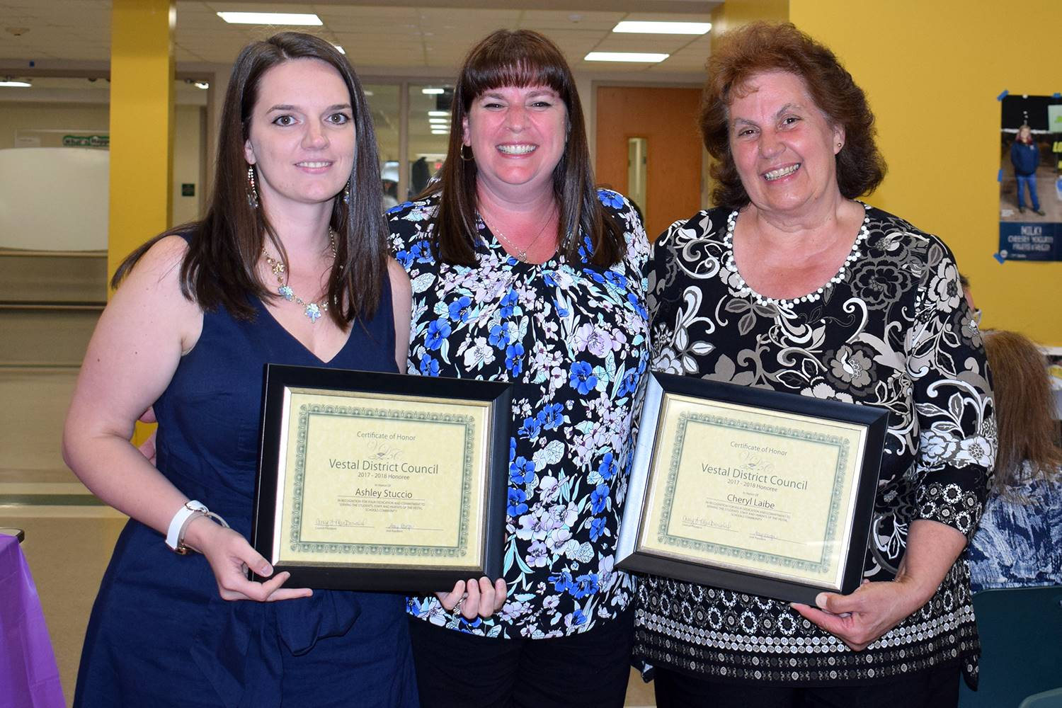 Vestal Hills Elementary Parent-Teacher Association president presents her school's two honorees