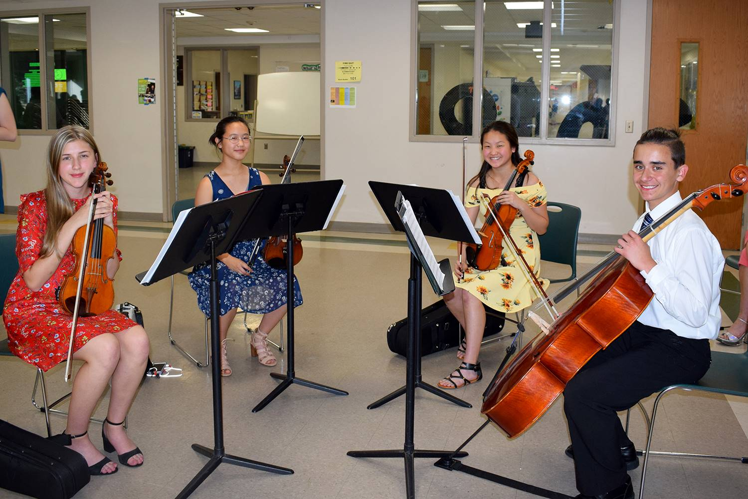 A string quartet comprised of student musicians from the Vestal Middle School Orchestra play at the