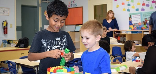 A Vestal Hills first-grader helps one of his brother's classmates with a LEGO toy during the Universal Pre-Kindergarten Orientation at the Jewish Community Center campus on September 4, 2018