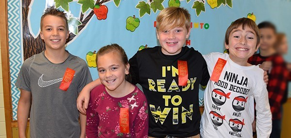 Four Tioga Hills Elementary fifth-graders, a girl and three boys, proudly wear their red ribbons on Red Ribbon Day, October 18, 2019.