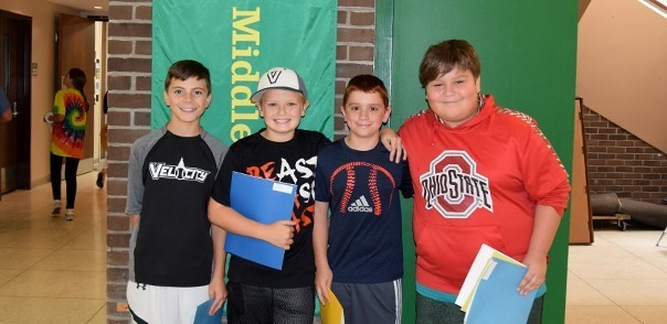 Four sixth-grade boys stand for a photo in the Vestal Middle School lobby during Sixth-grade Orientation on August 26, 2019.
