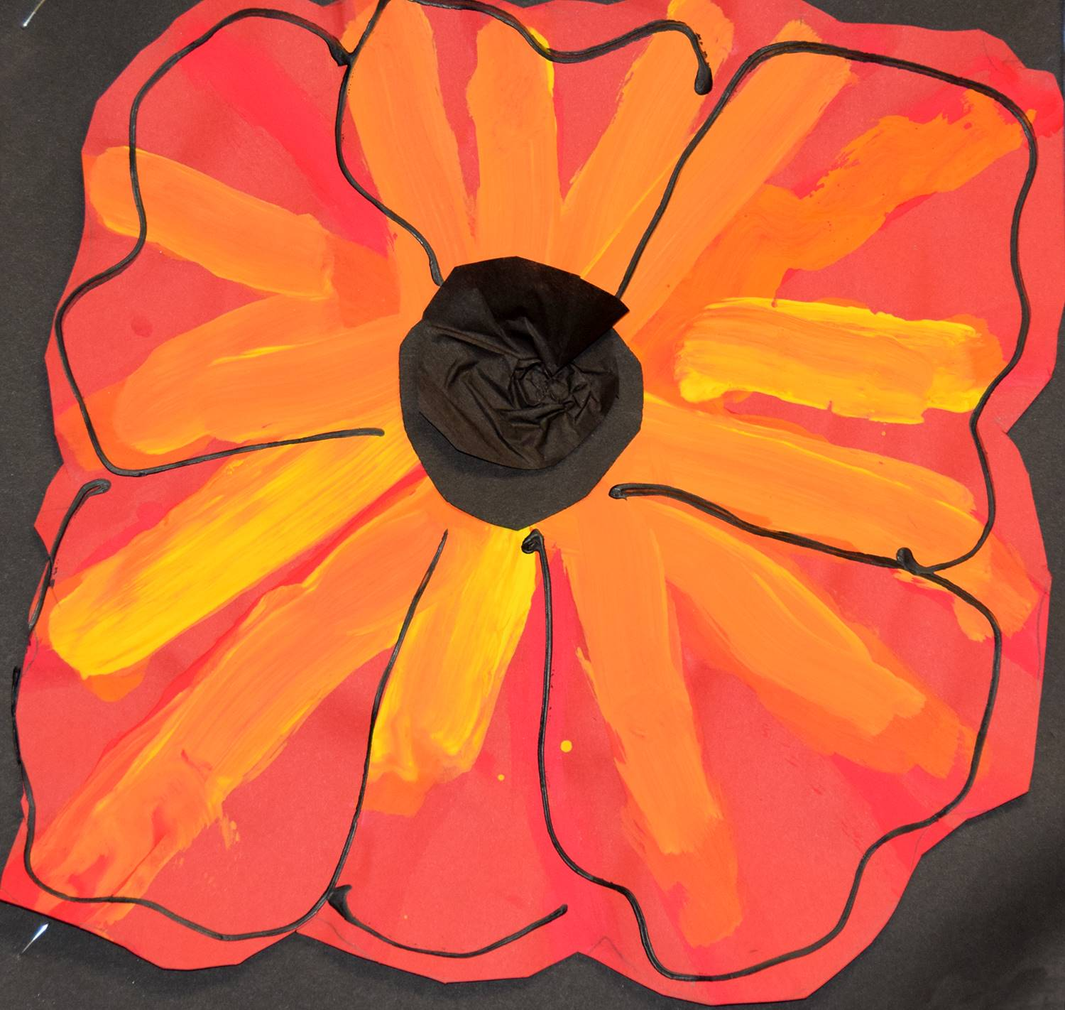 An orange and red poppy flower on black background by Gavin, a Clayton Avenue Elementary student.