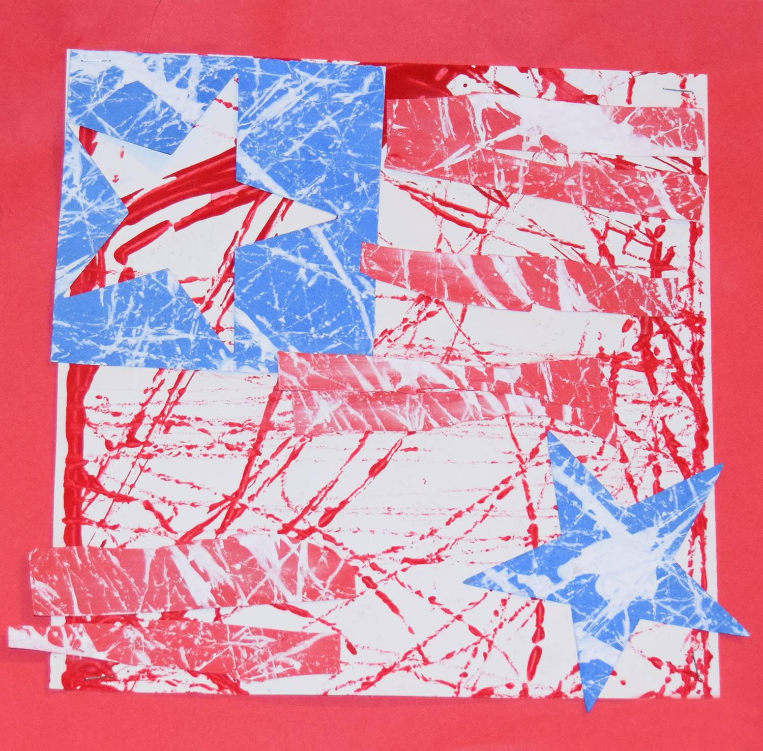 A red, white and blue montage of paint-splattered stars by John, a Clayton Avenue Elementary student