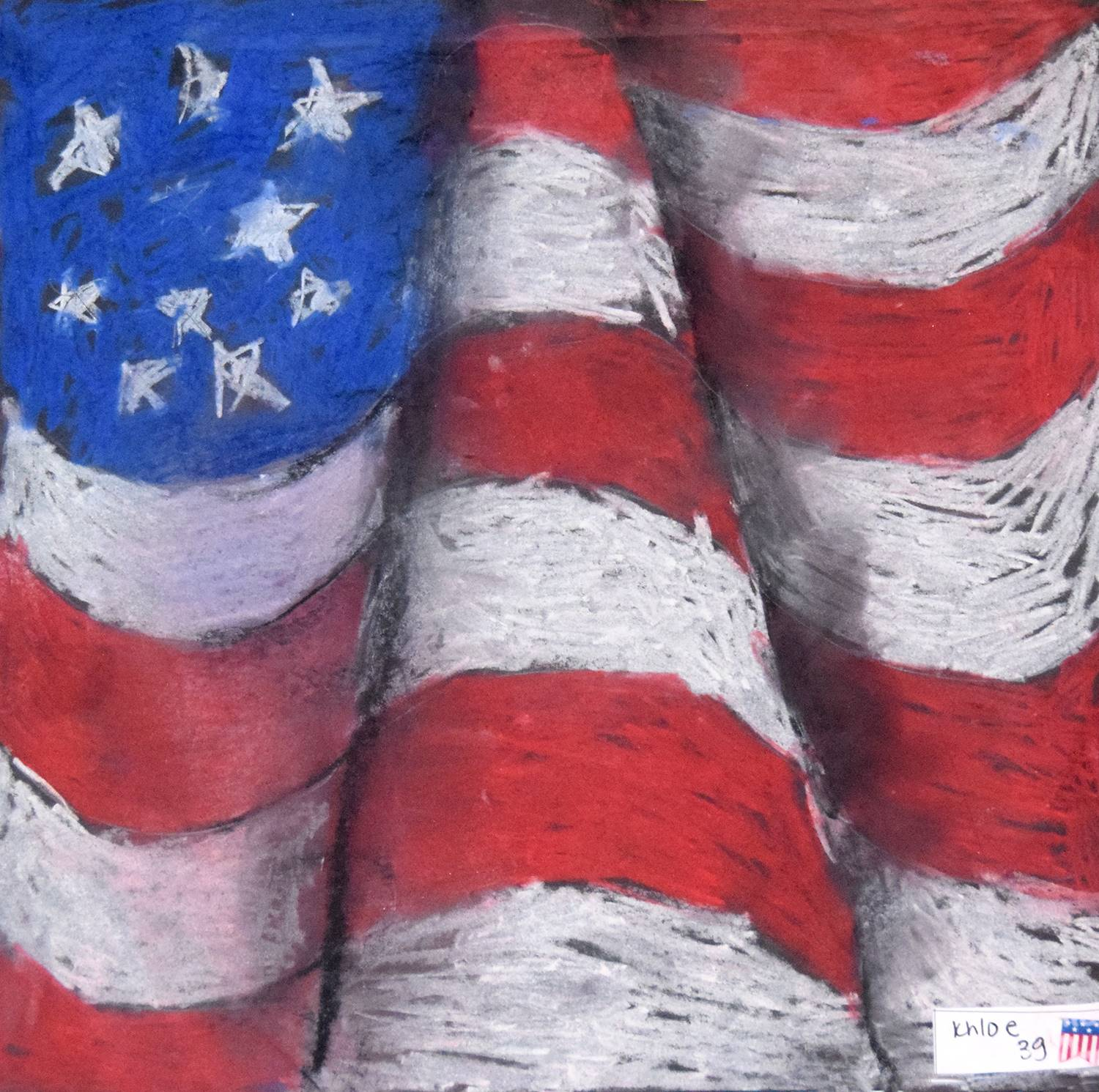 A red, white and blue American flag in pastel chalks by Khloe, Clayton Avenue Elementary School.