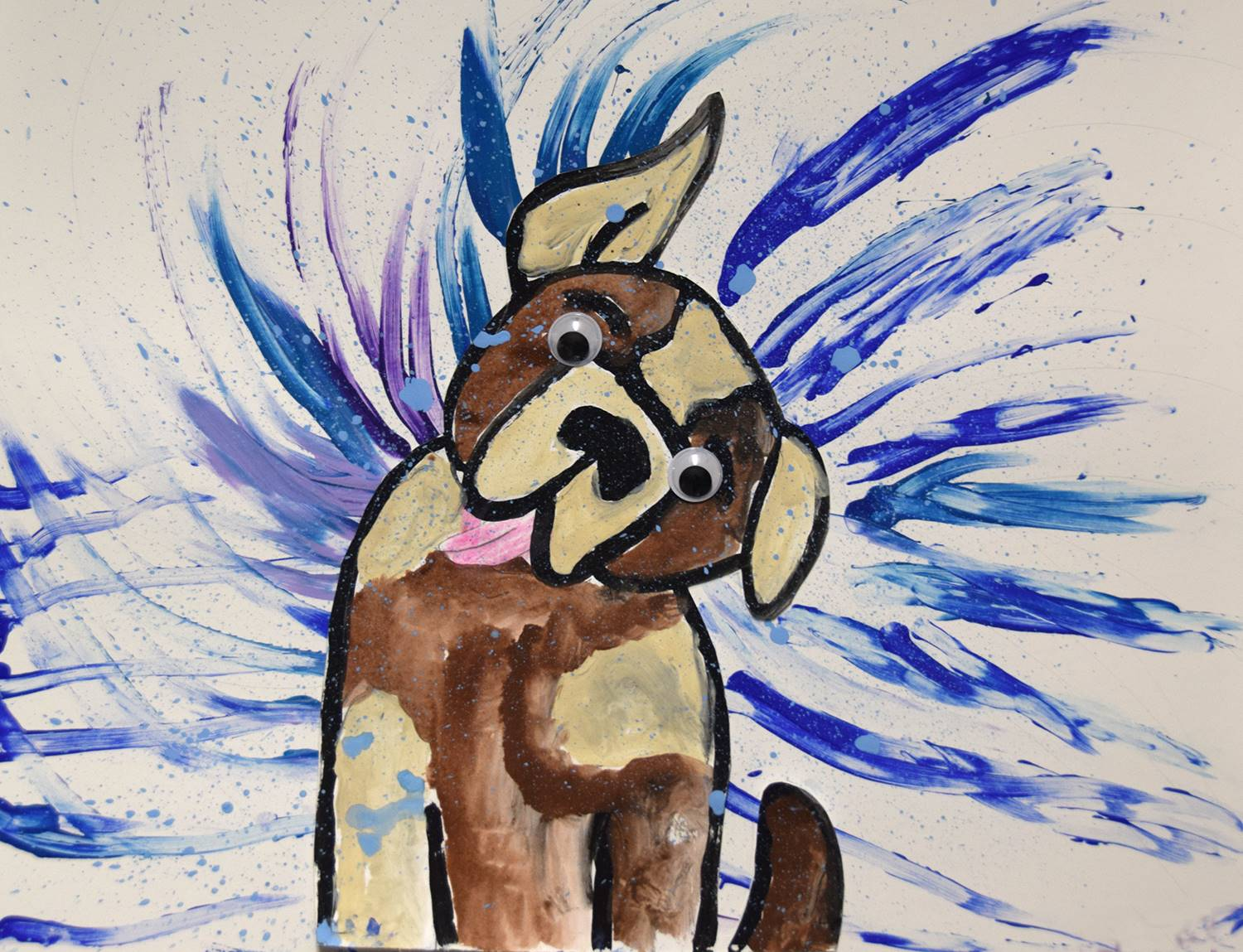 A tan and brown bull dog shaking water off of himself, by Anthony, Glenwood Elementary School.
