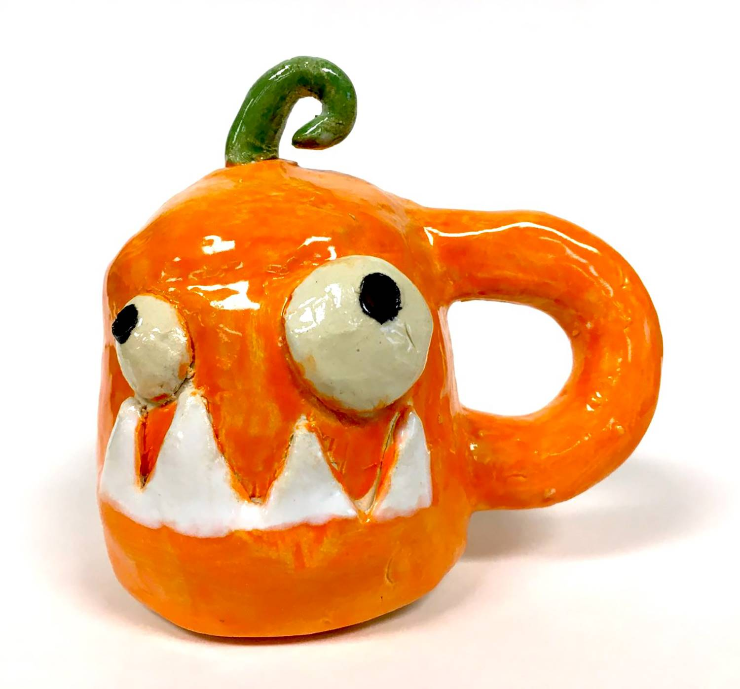 A orange ceramic monster made by a Vestal Middle School student that looks like a warped jack o'lant
