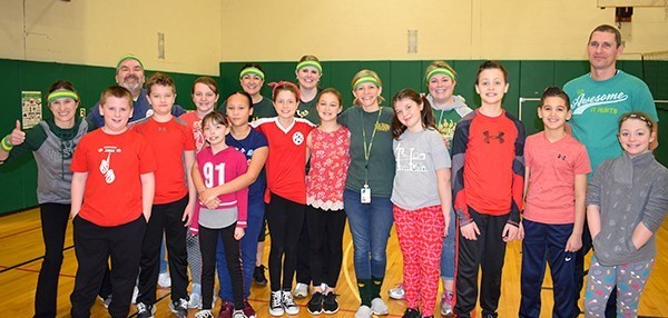 Mrs. Steele's fifth-grade class pose with other teachers who competed against them in annual Staff versus Students Volleyball game in the Tioga Hills Elementary School gym.