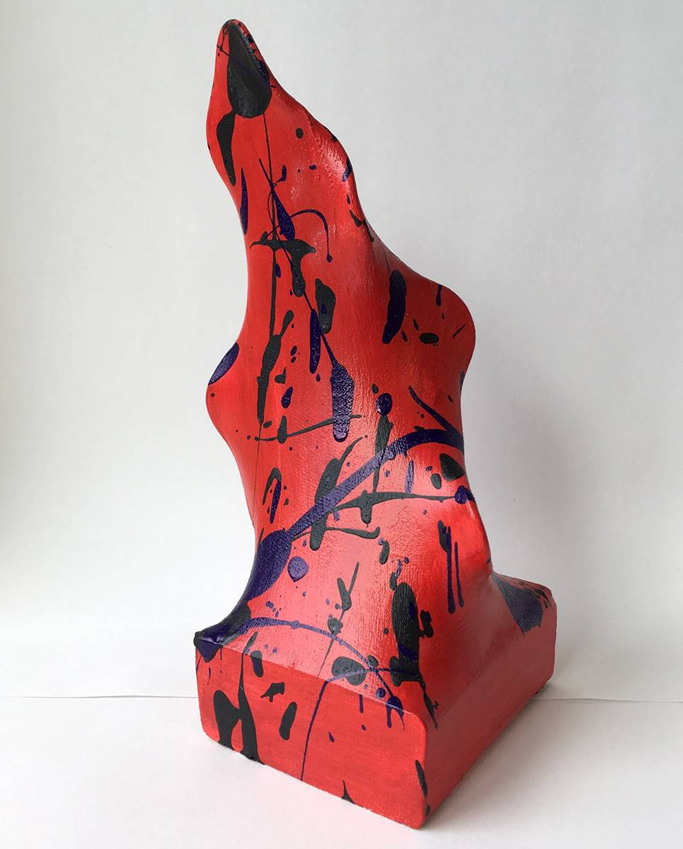 Red abstract sculpture with blue paint spatter by a Vestal Middle School student.