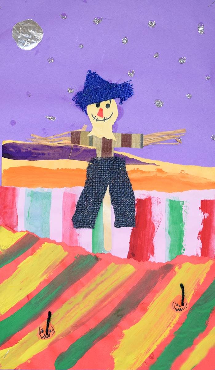 A brightly created paper and painted piece shows a scarecrow in a field.