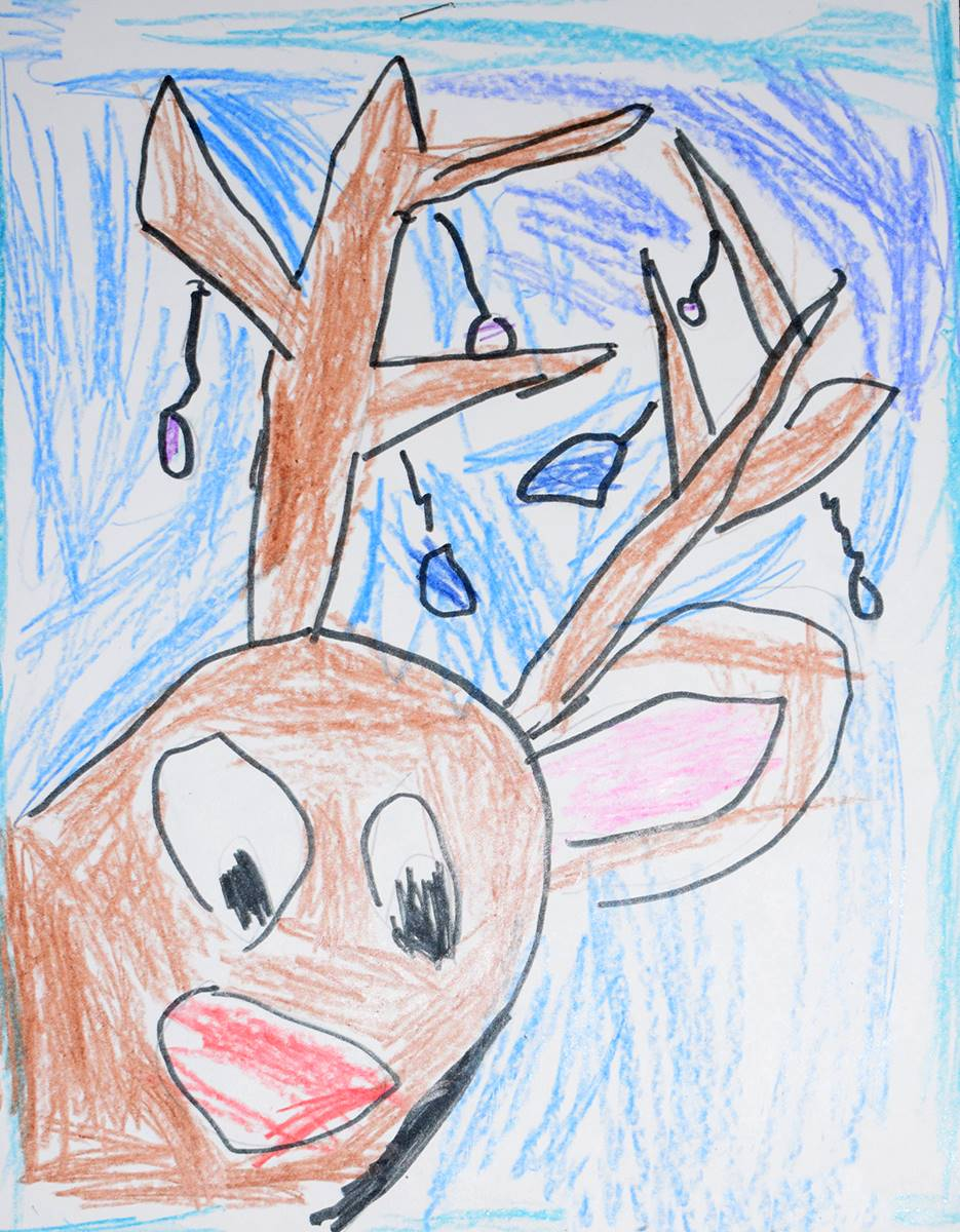 A brown reindeer with red nose and Christmas bulbs hanging off of its antlers seems to lean into the