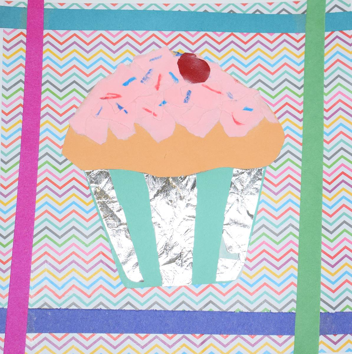 Mixed-media artwork of a strawberry cupcake with sprinkles and a red cherry on top in a teal-blue an
