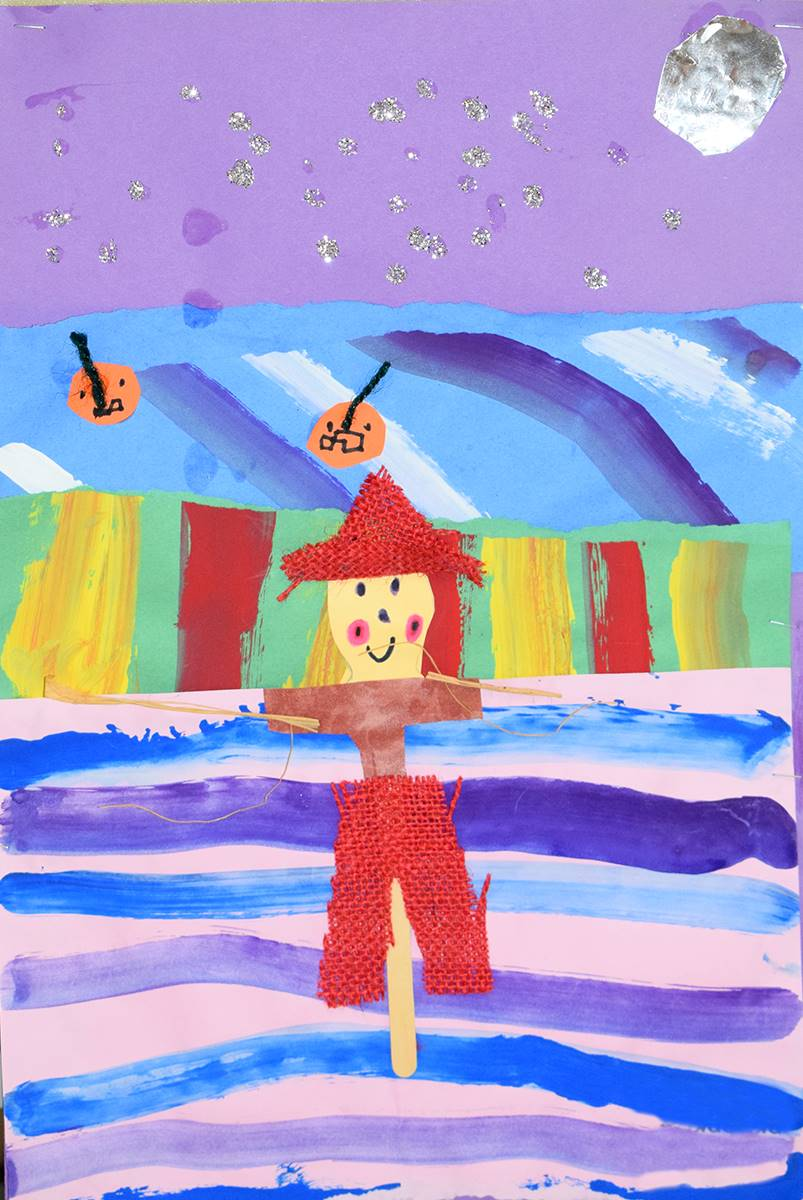 A brightly colored mixed-media piece by a Clayton Avenue Elementary student shows a scarecrow in a f