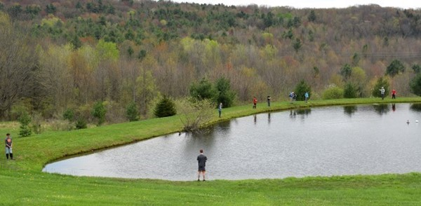Vestal Middle School students in the Friday Fly-fishing Club are scattered around the perimeter of Van Gorder's pond in Vestal as they enjoy some catch and release fishing on their last day of this club.