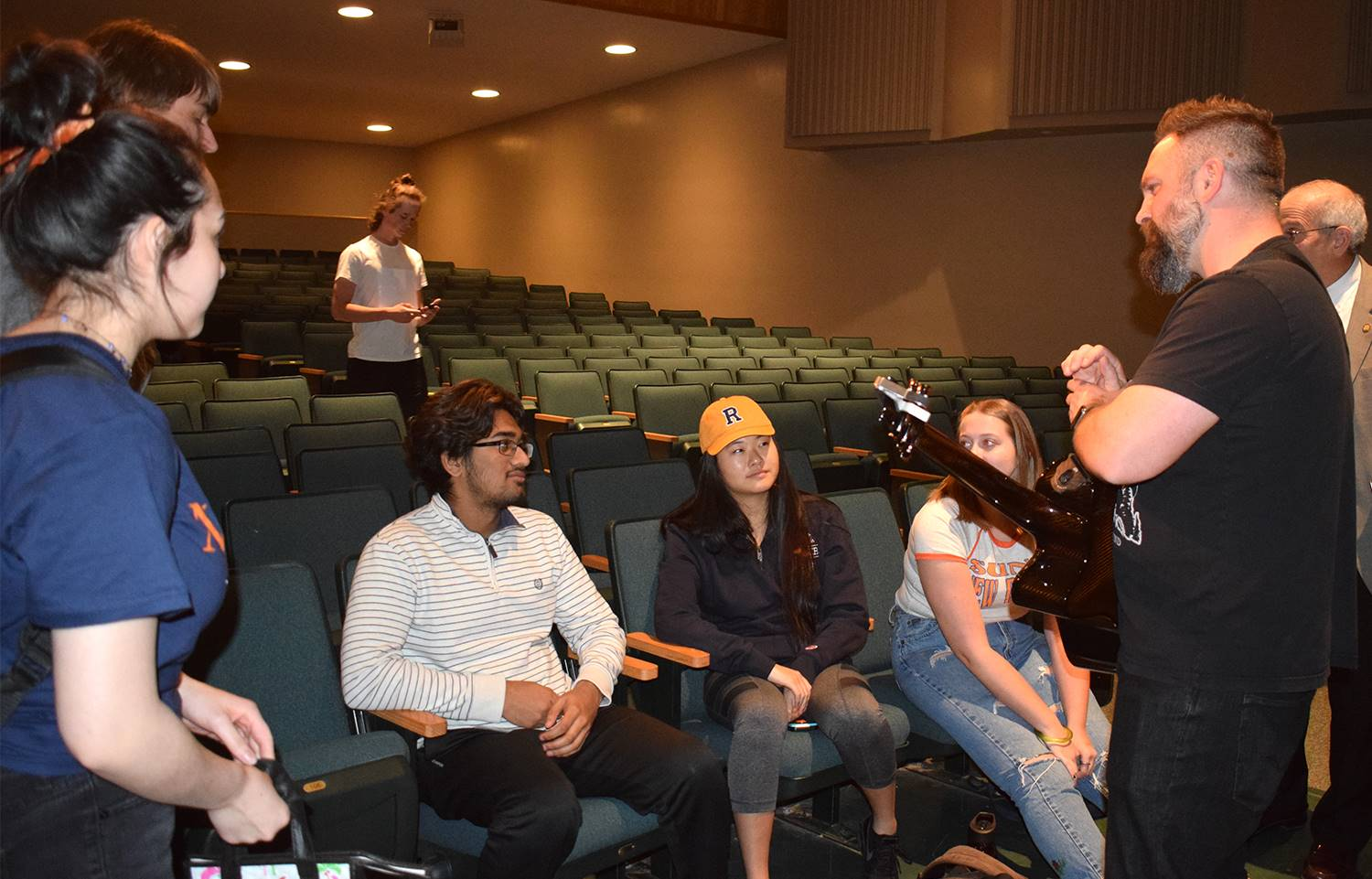 Jared Campbell talks with students after his presentation in the Vestal High School auditorium on Ma
